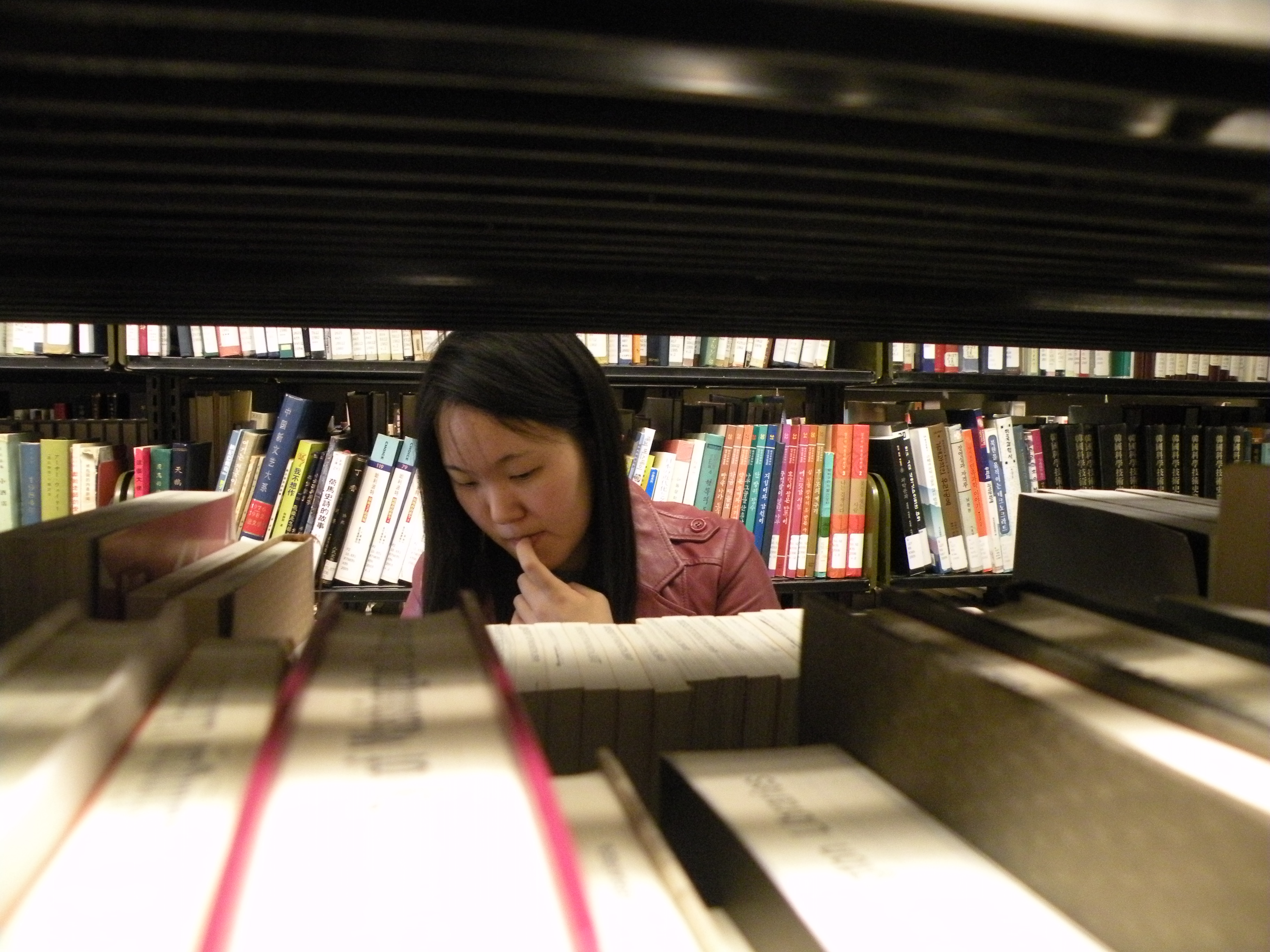 Woman standing in stacks