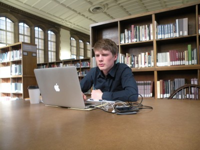 Man studying with computer in East Asia reading room