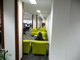 Foster Library Studying in Green Chairs