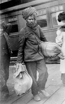Sikh With Two Bags
