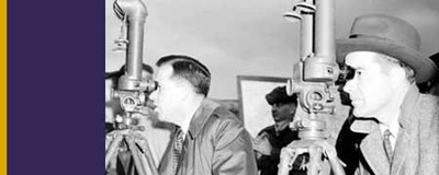 Senator Henry M. Jackson and Congressman Ed Edmundson looking through observation periscopes